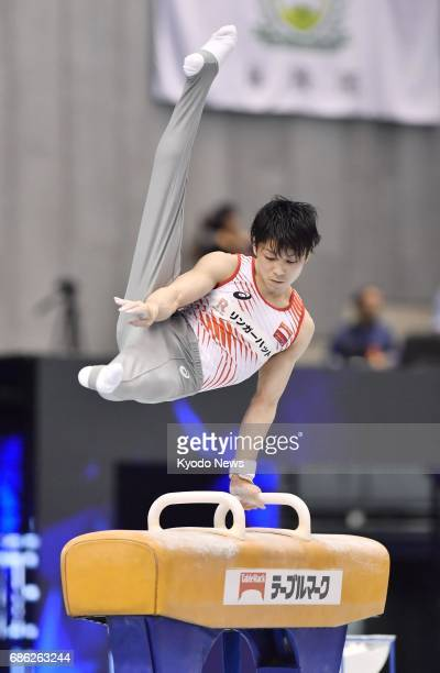 Kohei Uchimura twotime Olympic gymnastics individual allaround gold medalist performs his pommel horse routine during the NHK Cup at the Tokyo...