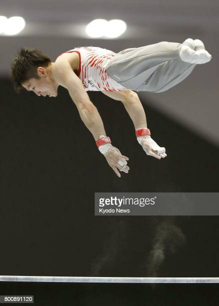 Kohei Uchimura twotime Olympic gymnastics individual allaround gold medalist performs his horizontal bar routine during the national apparatus...