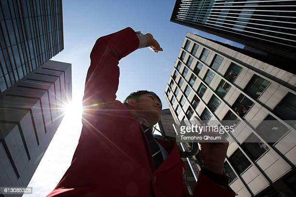 Kohei Uchimura waves from the top of a double decker bus during the Rio Olympics 2016 Japanese medalist parade in the ginza district on October 7...