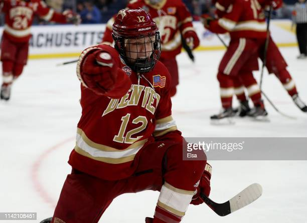 Kohen Olischefski of the Denver Pioneers celebrates his goal in the first period against the Massachusetts Minutemen during the semifinals of the...