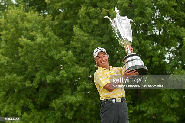 Kohki Idoki of Japan 2013 Senior PGA Champion poses for the media with the Alfred Bourne Trophy after the final round of the 74th Senior PGA...