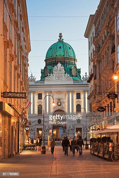 kohlmarkt and hofburg palace in vienna at dusk - small group of people stock pictures, royalty-free photos & images