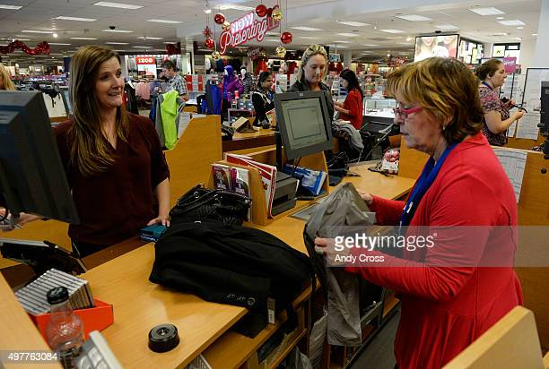Kohl's cashier Joyce Goldman left processes a purchase from customer Kaycee Dunn at the Lone Tree store November 18 2015 Photo by Andy Cross/The...