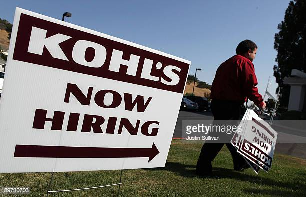 Kohl's employee Chris Torres sets up signs pointing to the Kohl's job fair at the Embassy Suites hotel August 10 2009 in San Rafael California...