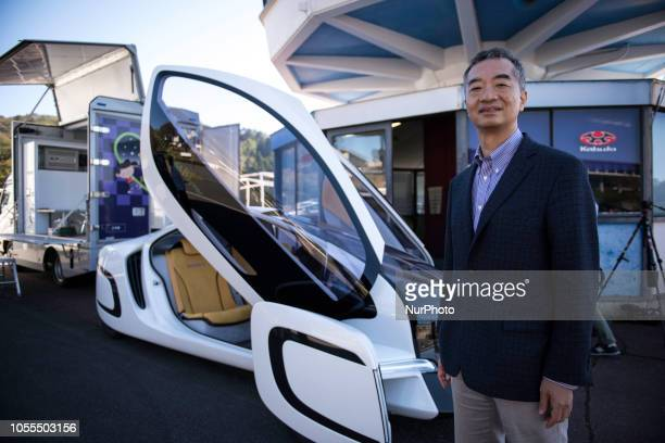 Kohzo Ito a professor at the University of Tokyo posed in front of a prototype car using carbon fiber reinforced plastic made it's testing in Japan...