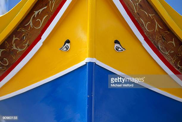 close detail of the front of a brightly painted boat, with two eyes. - koi painting stock photos and pictures