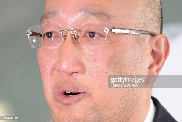 Koichi Kawana president of Japan's plant construction company JGC holds back tears as he answers questions during a press conference at the...