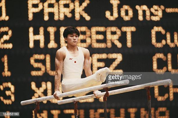 Koichi Mizushima of Japan performs in the Men's Parallel Bars event on 21st October 1987 during the World Artistic Gymnastics Championships in...