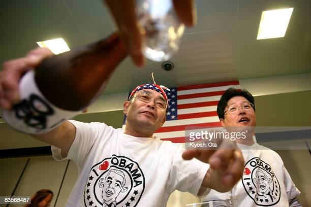 Koichi Morii employee of Obama Kaisanbutsu serves sake during a celebration party for the Presidentelect US Sen Barack Obama following his victory in...