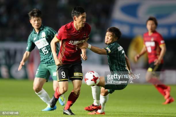 Koichi Sato of Zweigen Kanagawa and Paulo Junichi Tanaka of FC Gifu compete for the ball during the JLeague J2 match between FC Gifu and Zweigen...