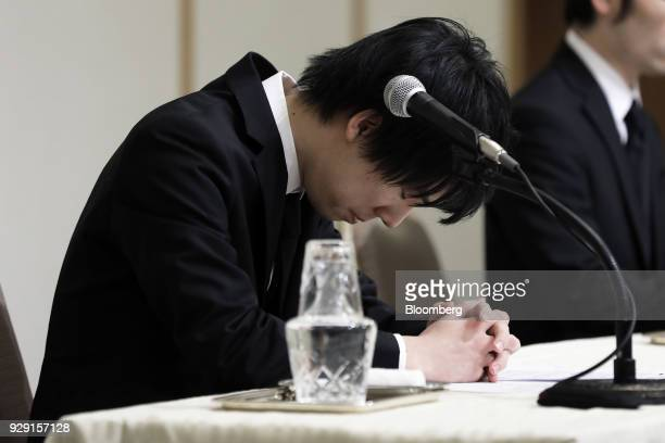 Koichiro Wada president of Coincheck Inc bows during a news conference in Tokyo Japan on Thursday March 8 2018 Coincheck said it will start...