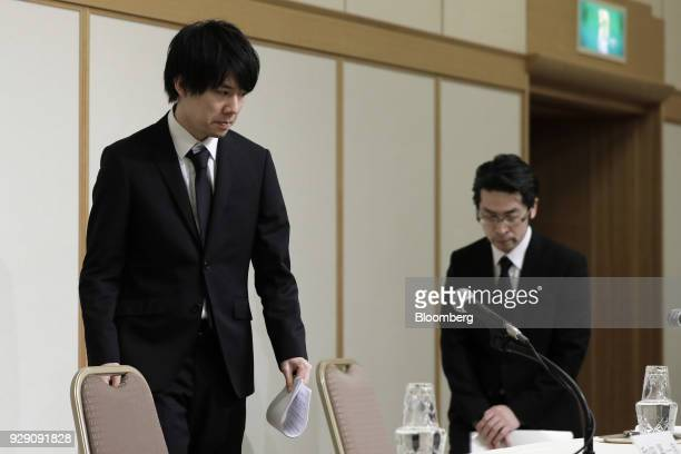 Koichiro Wada president of Coincheck Inc left and Yusuke Otsuka chief operating officer arrive for a news conference in Tokyo Japan on Thursday March...