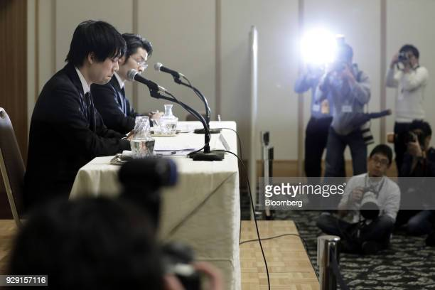 Koichiro Wada president of Coincheck Inc left and Yusuke Otsuka chief operating officer of Coincheck Inc attend a news conference in Tokyo Japan on...