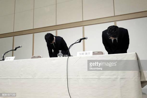 Koichiro Wada president of Coincheck Inc left and Yusuke Otsuka chief operating officer of Coincheck Inc bow during a news conference in Tokyo Japan...