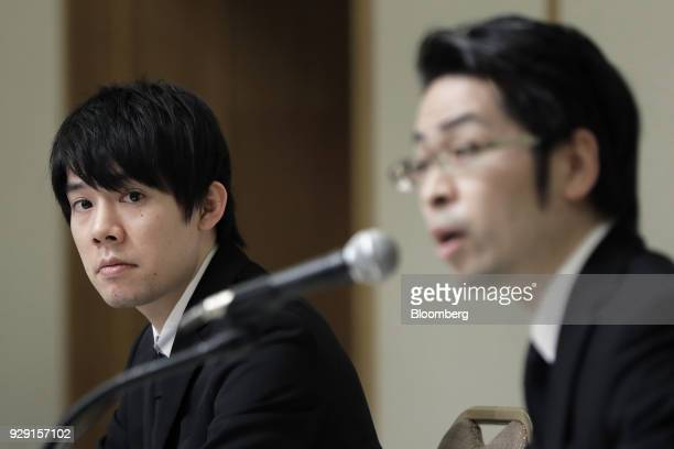 Koichiro Wada president of Coincheck Inc left looks on as Yusuke Otsuka chief operating officer of Coincheck Inc speaks during a news conference in...