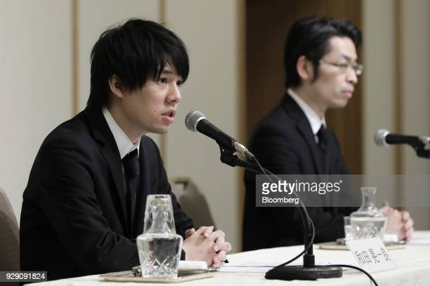 Koichiro Wada president of Coincheck Inc left speaks while Yusuke Otsuka chief operating officer look on during a news conference in Tokyo Japan on...
