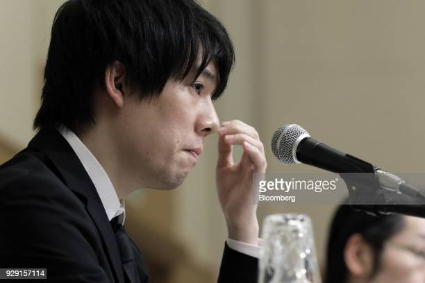 Koichiro Wada president of Coincheck Inc reacts during a news conference in Tokyo Japan on Thursday March 8 2018 Coincheck said it will start...