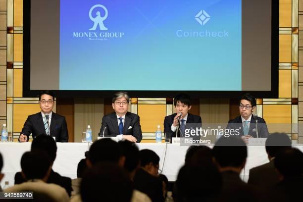 Koichiro Wada president of Coincheck Inc second right speaks as Yusuke Otsuka chief operating officer of Coincheck Inc right Toshihiko Katsuya chief...