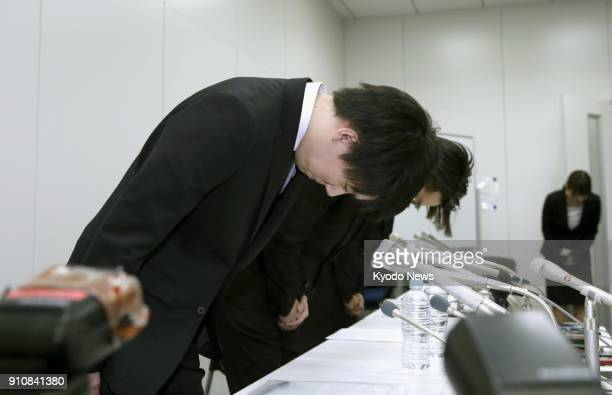 Koichiro Wada president of cryptocurrency exchange Coincheck bows in apology at the start of a press conference in Tokyo on Jan 26 after around 58...