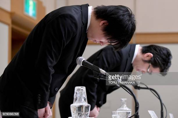 Koichiro Wada president of Japan's virtual currency exchange Coincheck and board member Yusuke Otsuka bow at the beginning of a press conference in...