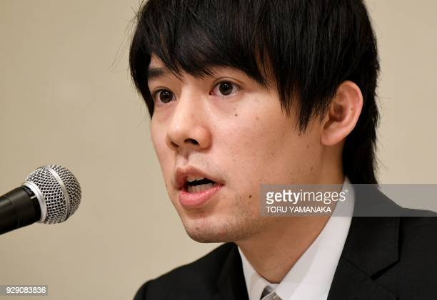 Koichiro Wada president of Japan's virtual currency exchanges Coincheck speaks during a press conference in Tokyo on March 8 2018 The hack of...