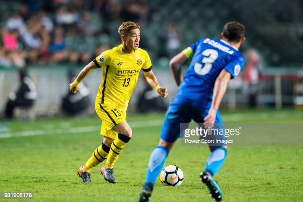 Koike Ryuta of Kashiwa Reysol competes for the ball with Daniel Cancela Rodriguez of Kitchee SC during the AFC Champions League Group E match between...