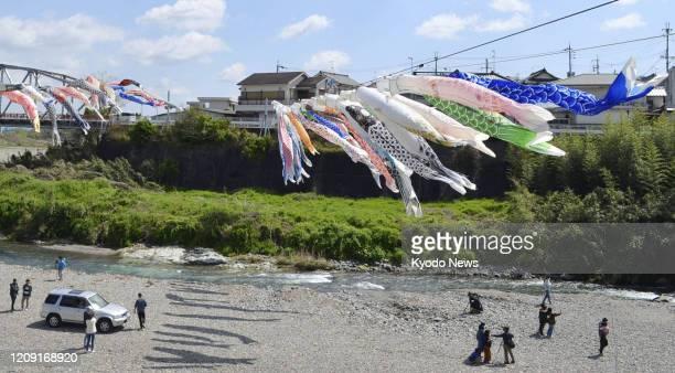 """Koinobori"" carp streamers fly over a river in Kudoyama, Wakayama Prefecture, western Japan, on April 5, 2020. Koinobori will be displayed through..."
