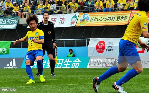 Koji Hirose of Tochigi SC scores his team's first goal during the JLeague third division match between Tochigi SC and Fujieda MYFC at the Tochigi...