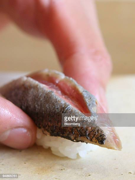 Koji Kiyota Hozumi sushi restaurant owner and chef prepares a piece of sushi with Sanma in Tokyo Japan on Friday Oct 17 2008 Hozumi is located in the...