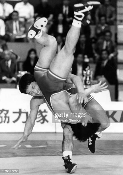 Koji Miyahara throws Takamasa Isshiki in the Men's GrecoRoman 52kg final during the All Japan Wrestling Championships at the Yoyogi National...