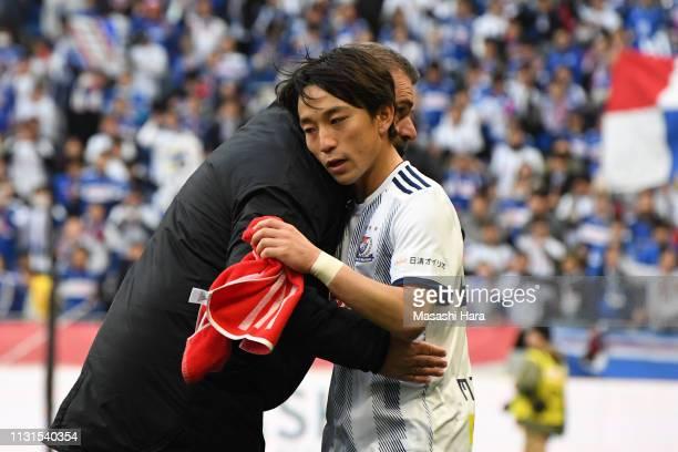 Koji Miyoshi and Ange Postecoglou of Yokohama FMarinos celebrate the win after the JLeague J1 match between Gamba Osaka and Yokohama FMarinos at...