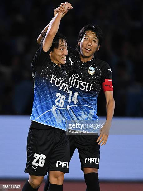 Koji Miyoshi and Kengo Nakamura of Kawasaki Frontale celebrate their second goal during the J.League match between Kawasaki Frontale and Ventforet...