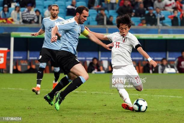 Koji Miyoshi of Japan a shot during the Copa America Brazil 2019 group C match between Uruguay and Japan at Arena do Gremio on June 20, 2019 in Porto...