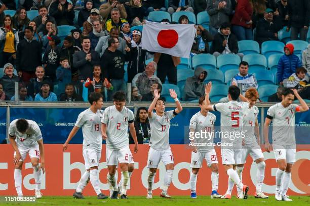 Koji Miyoshi of Japan celebrates his second goal of the game with teammates during the Copa America Brazil 2019 group C match between Uruguay and...