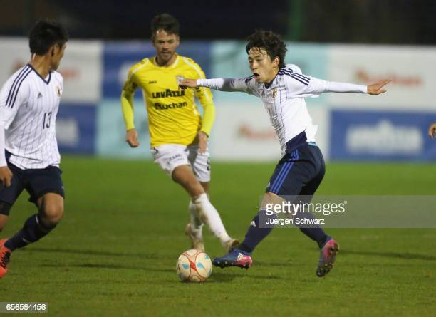 Koji Miyoshi of Japan controls the ball during a friendly soccer match between F91 Diddeleng and the Japan U20 team at Stade Jos Nosbaum on March 22...