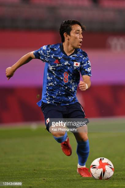 Koji Miyoshi of Japan dribbles the ball during the Men's Quarter Final match against Team New Zealand on day eight of the Tokyo 2020 Olympic Games at...