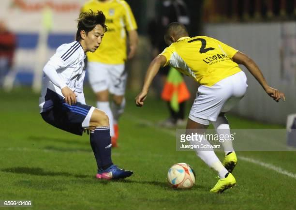 Koji Miyoshi of Japan tackles Clayton de Sousa of F91 during a friendly soccer match between F91 Diddeleng and the Japan U20 team at Stade Jos...