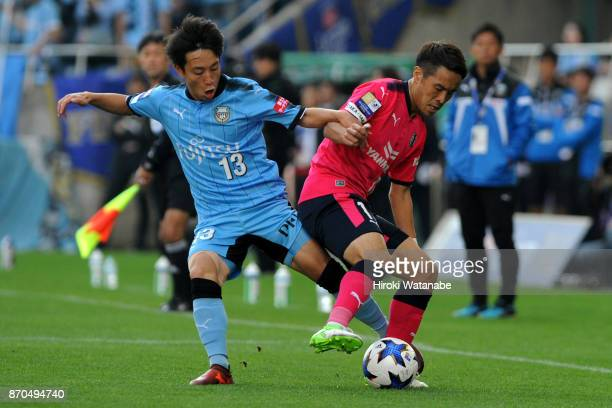 Koji Miyoshi of Kawasaki Frontale and Kota Mizunuma of Cerezo Osaka compete for the ball during the JLeague Levain Cup final match between Cerezo...
