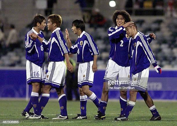 Koji Nakata Junichi Inamoto Masashi Motoyama Yuji Nakazawa and Naohiro Takahara of Japan celebrate the win after the Sydney Olympics Men's Football...