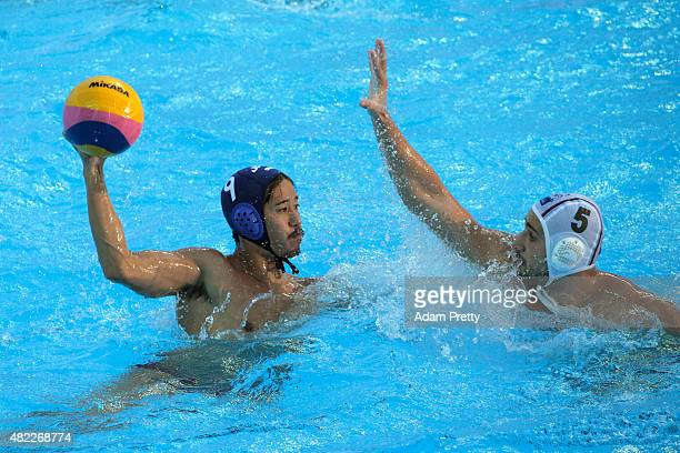 Koji Takei of Japan is closed down by Milos Cuk of Serbia in the Men's Water Polo Preliminary Round Group D match between Serbia and Japan on day...