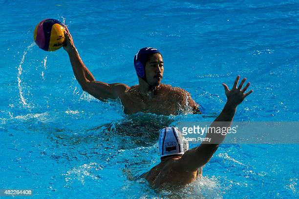 Koji Takei of Japan looks to pass in the Men's Water Polo Preliminary Round Group D match between Serbia and Japan on day five of the 16th FINA World...