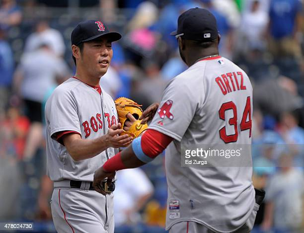 Koji Uehara and David Ortiz of the Boston Red Sox celebrate a 132 win against the Kansas City Royals in the ninth inning at Kauffman Stadium on June...