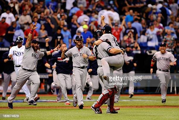 Koji Uehara and David Ross of the Boston Red Sox celebrate after the Boston Red Sox defeated the Tampa Bay Rays 3-1 in Game Four of the American...