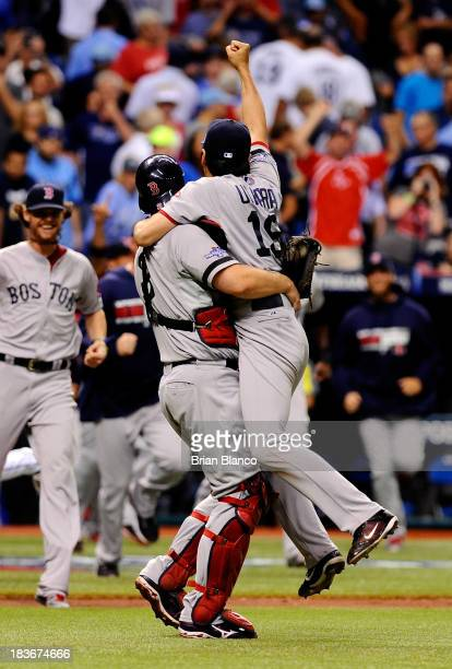 Koji Uehara and David Ross of the Boston Red Sox celebrate after the Boston Red Sox defeated the Tampa Bay Rays 31 in Game Four of the American...