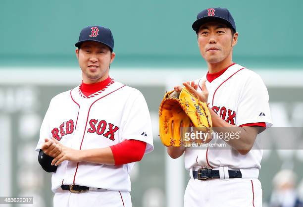 Koji Uehara and Junichi Tazawa of the Boston Red Sox stand at the mound during a pregame ceremony prior to the game against the Texas Rangers at...