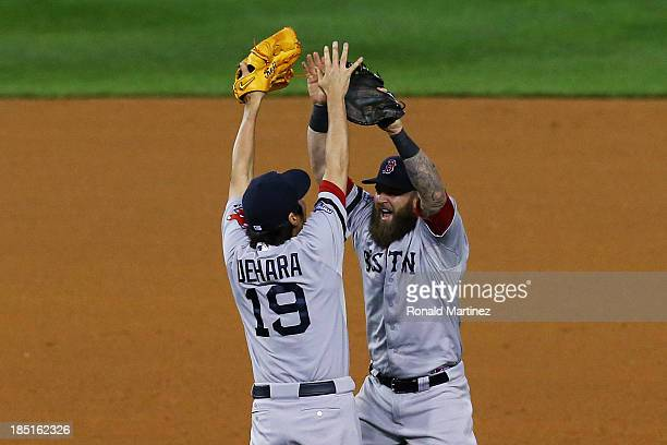 Koji Uehara and Mike Napoli of the Boston Red Sox celebrate their 4 to 3 win over the Detroit Tigers during Game Five of the American League...