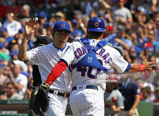 Koji Uehara and Willson Contreras of the Chicago Cubs celebrate after the 8th inning against the St Louis Cardinals at Wrigley Field on June 3 2017...