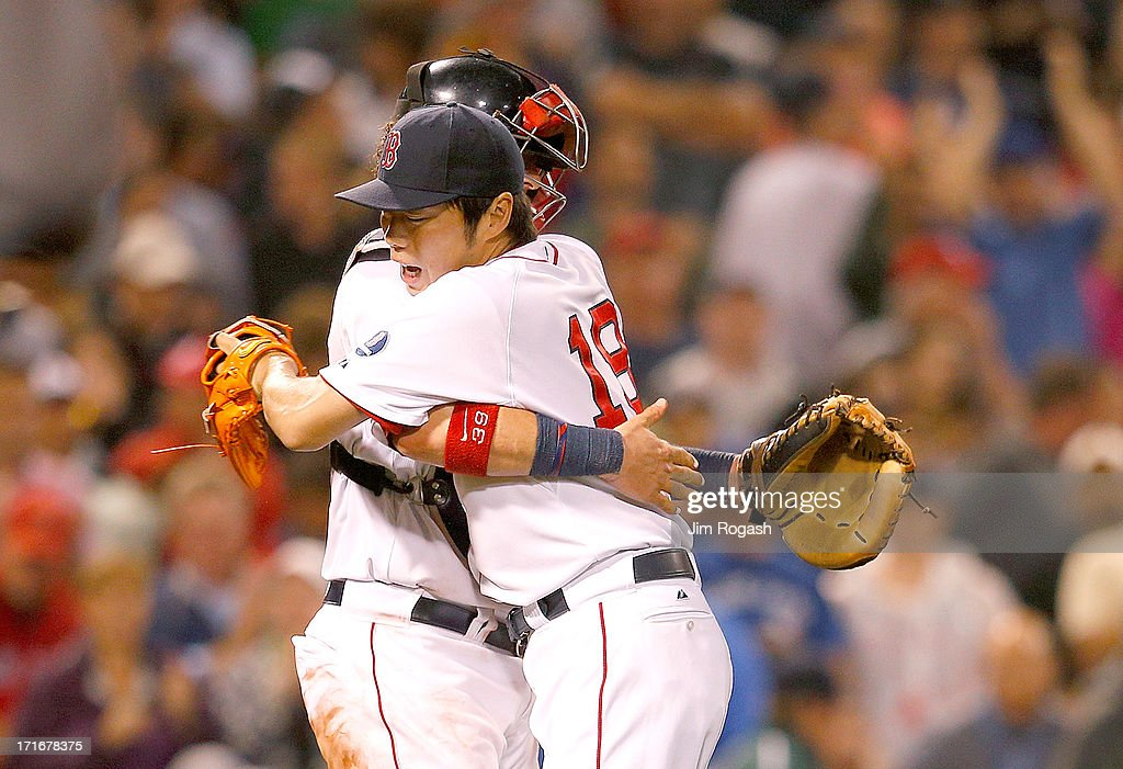 Koji Uehara #19 of the Boston Red Sox and Jarrod Saltalamacchia #39 embrace after defeating the Toronto Blue Jays, 7-4, at Fenway Park on June 27, 2013 in Boston, Massachusetts.