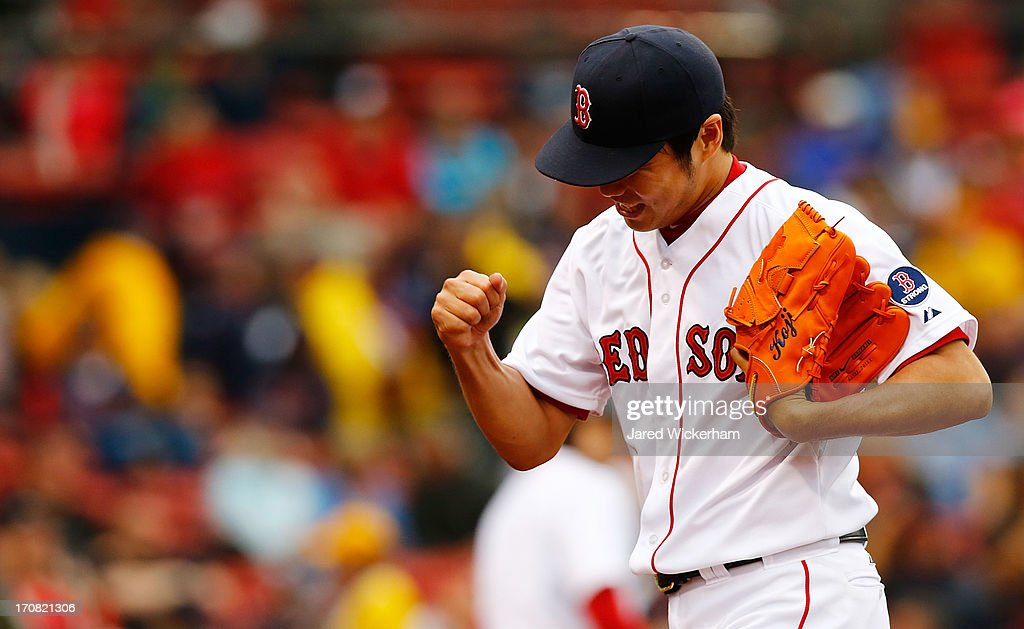Koji Uehara #19 of the Boston Red Sox celebrates after getting out of the eighth inning against the Tampa Bay Rays during the game on June 18, 2013 at Fenway Park in Boston, Massachusetts.