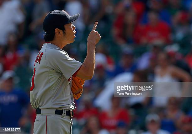 Koji Uehara of the Boston Red Sox celebrates after getting the final out in the bottom of the ninth inning to beat the Texas Rangers 52 at Globe Life...